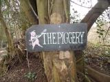 dcm_piggery_sign_tree.jpg